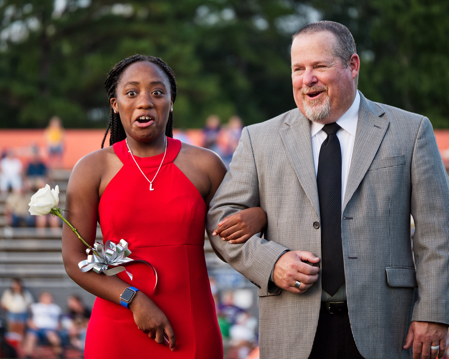 Lovely Wright is shocked to hear her name announced as homecoming queen; she is escorted by Kendall Banks.