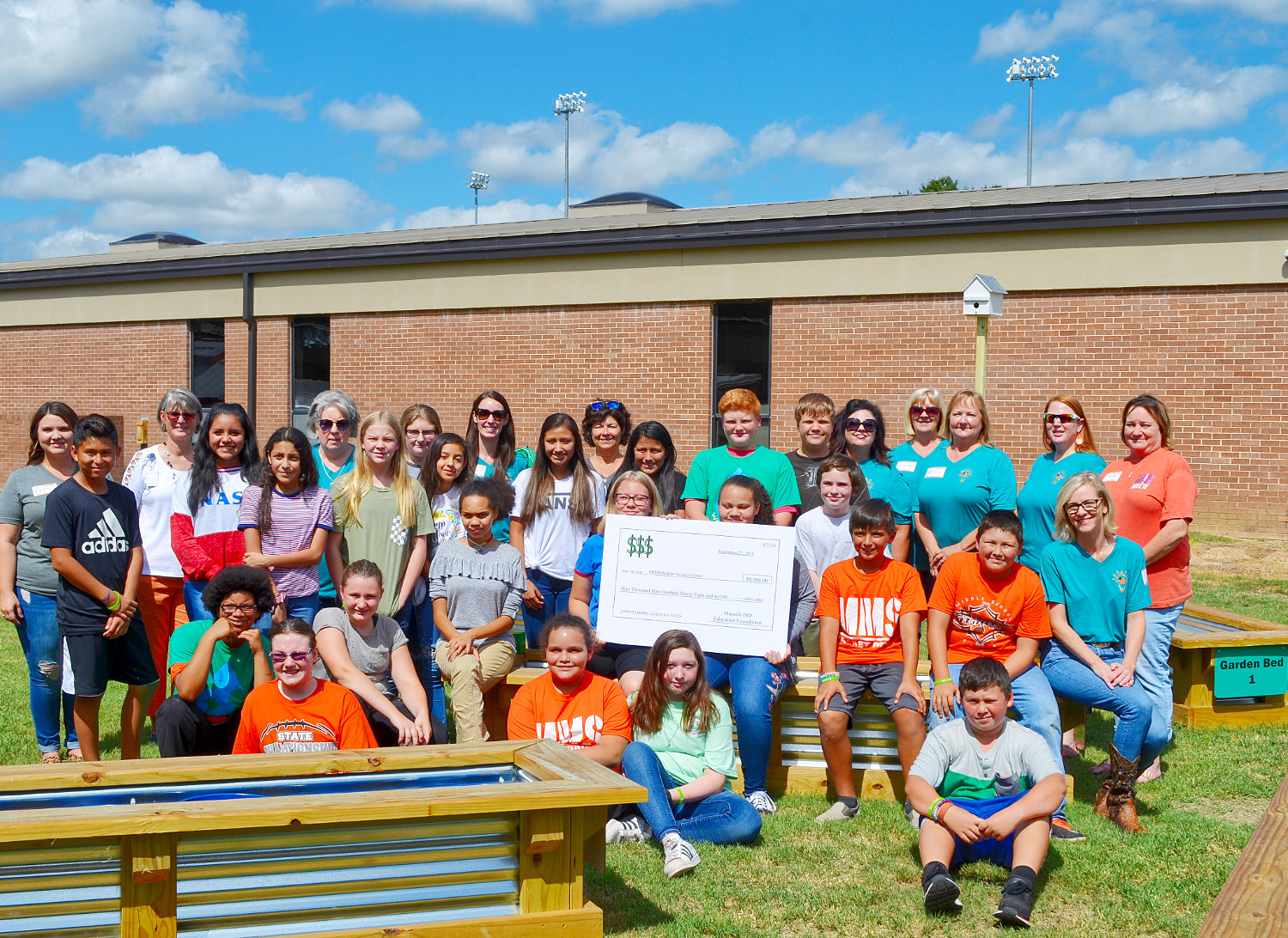 Mineola Middle School students celebrate their new outdoor science center which has benefited from numerous donations by individuals and companies.
