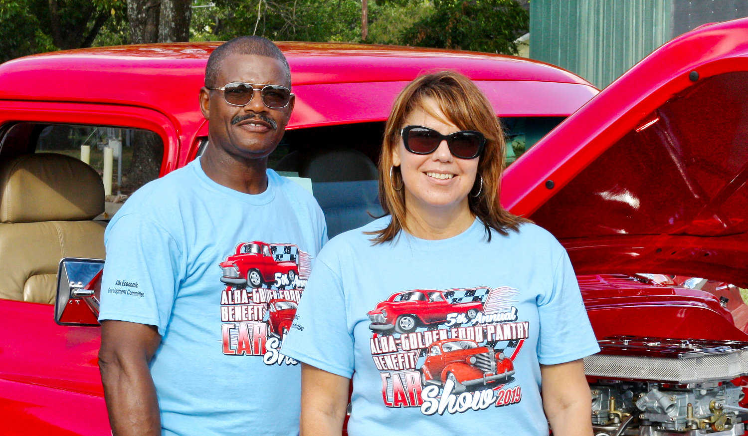 Angie Osborn, food bank coordinator, stands with last year's Best Truck winner, Lawrence Harper of Big Sandy at Saturday's Alba Food Bank car show. Harper restored a 1957 Chevy which he purchased in 1996.