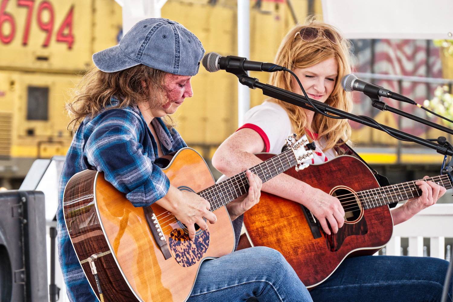 Heather Little and Meredith Crawford play as the Union Pacific train roars through the downtown area.