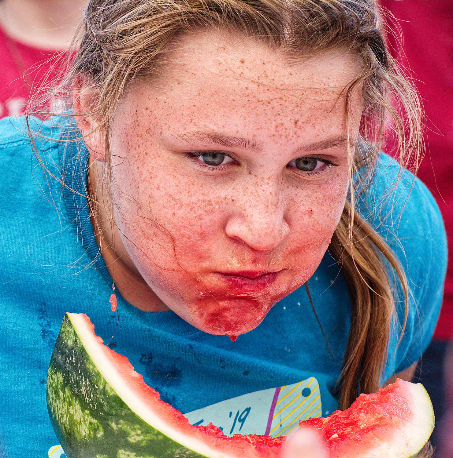 Carlee Cain of Mineola competes in the watermelon-eating contest during the Iron Horse Festival Saturday in downtown Mineola, which she won.