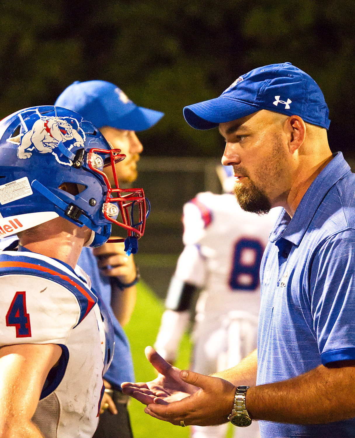 Bryan Morris gets some encouragement from Quitman coach Ryan Tierney.
