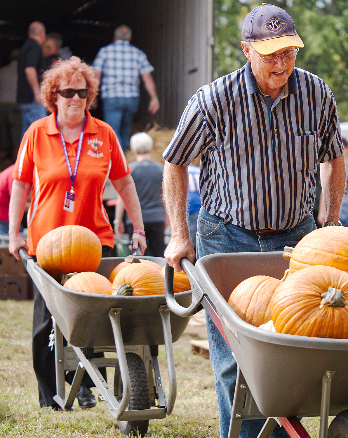 Sandy Bennett and Sam Curry wheel pumpkins from a truck at the First United Methodist Church in Mineola Monday in preparation for the church's annual pumpkin patch, which raises money for various children's ministries.