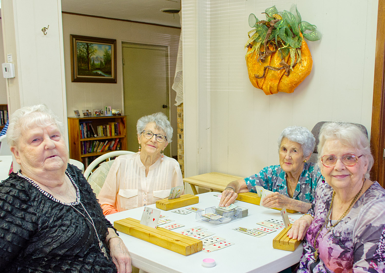 Ella Mae Clifton, (from left) Jeanette Treadaway, Sonja Vaughn and Linda Morgan meet at the Mineola Senior Citizen Center almost daily to play cards together. The center offers them fellowship and a place to connect.