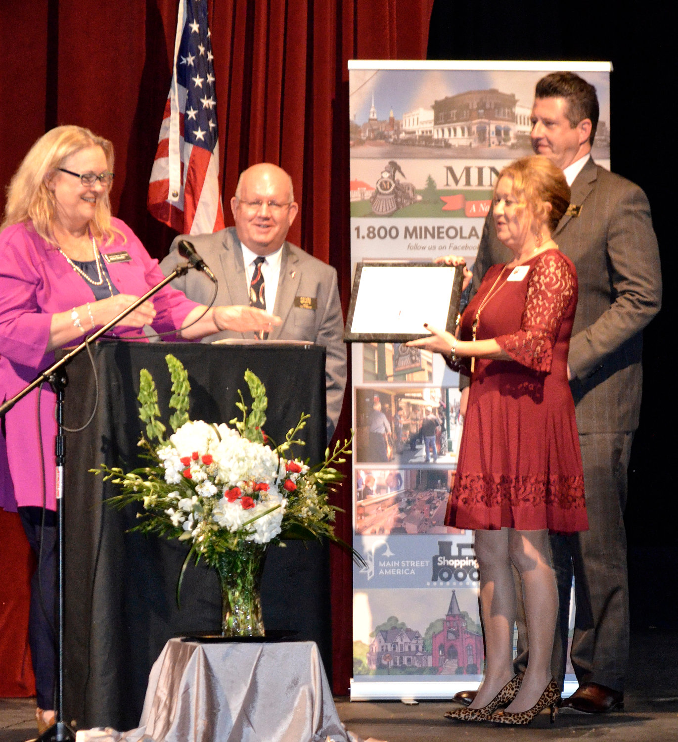 Debra Drescher, state coordinator of the Texas Main Street Program, presents recognition of Mineola's 30 years in the program to Mayor Kevin White, Main Street Manager Doris Newman and Main Street Board President Jason Ray.
