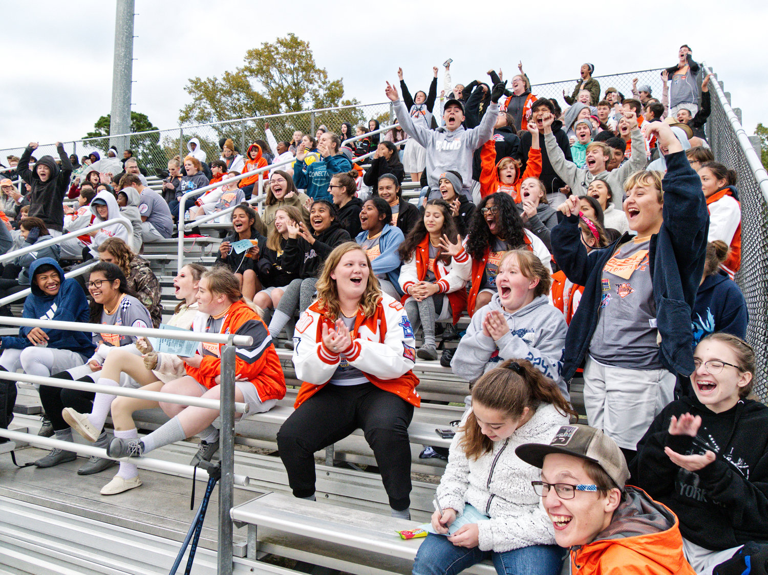 The Mineola band members celebrate making it to the out of prelims and into the finals Saturday afternoon.