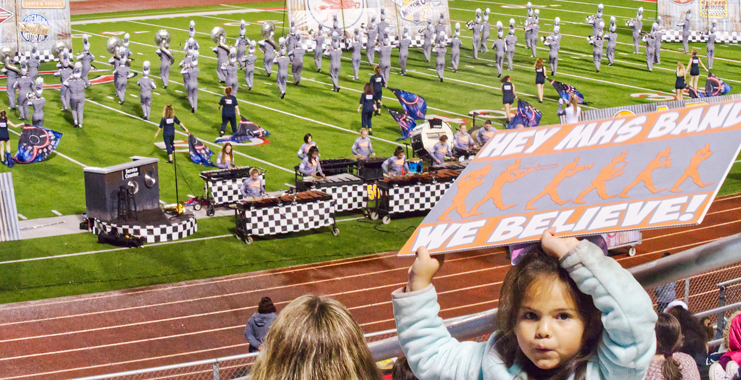 A young fan cheers on the band during their finals performance Saturday evening.