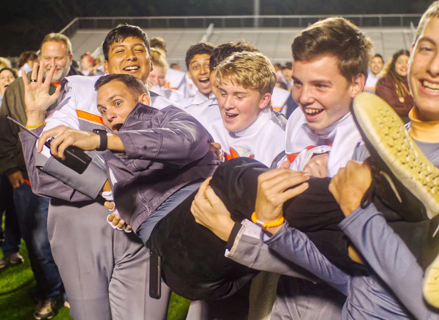 Student teacher Kyle Bennett gets carried away with celebrations by Mineola band students, from left, Jon Esquivel, Brian Bethel, Alex Castillo, Caden Moser Saturday in Carthage.