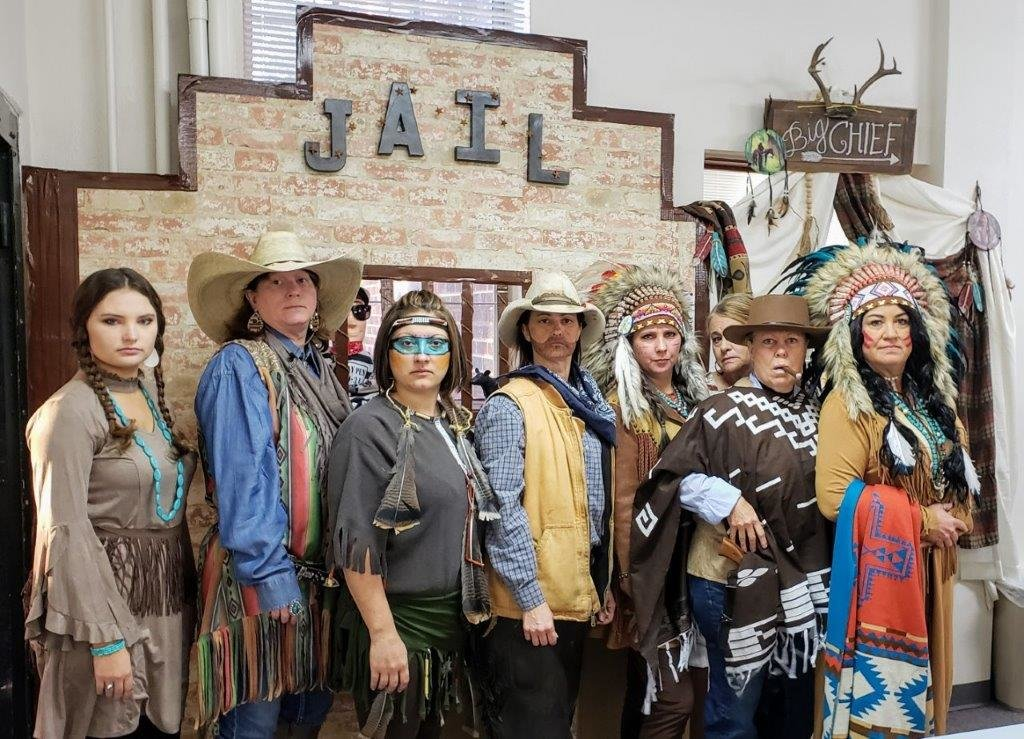 The ladies in the Wood County Clerk's Office got into the spirit of Halloween bringing back an Old West theme to the courthouse Oct. 31. They are (from left) Taryn Hamilton, Patty Sinclair, Sonya Pyron, Dachelle Hag- gerty, Chirstan Robinson, Vicky Red- ding, Shirley Burns and Kelley Price.
