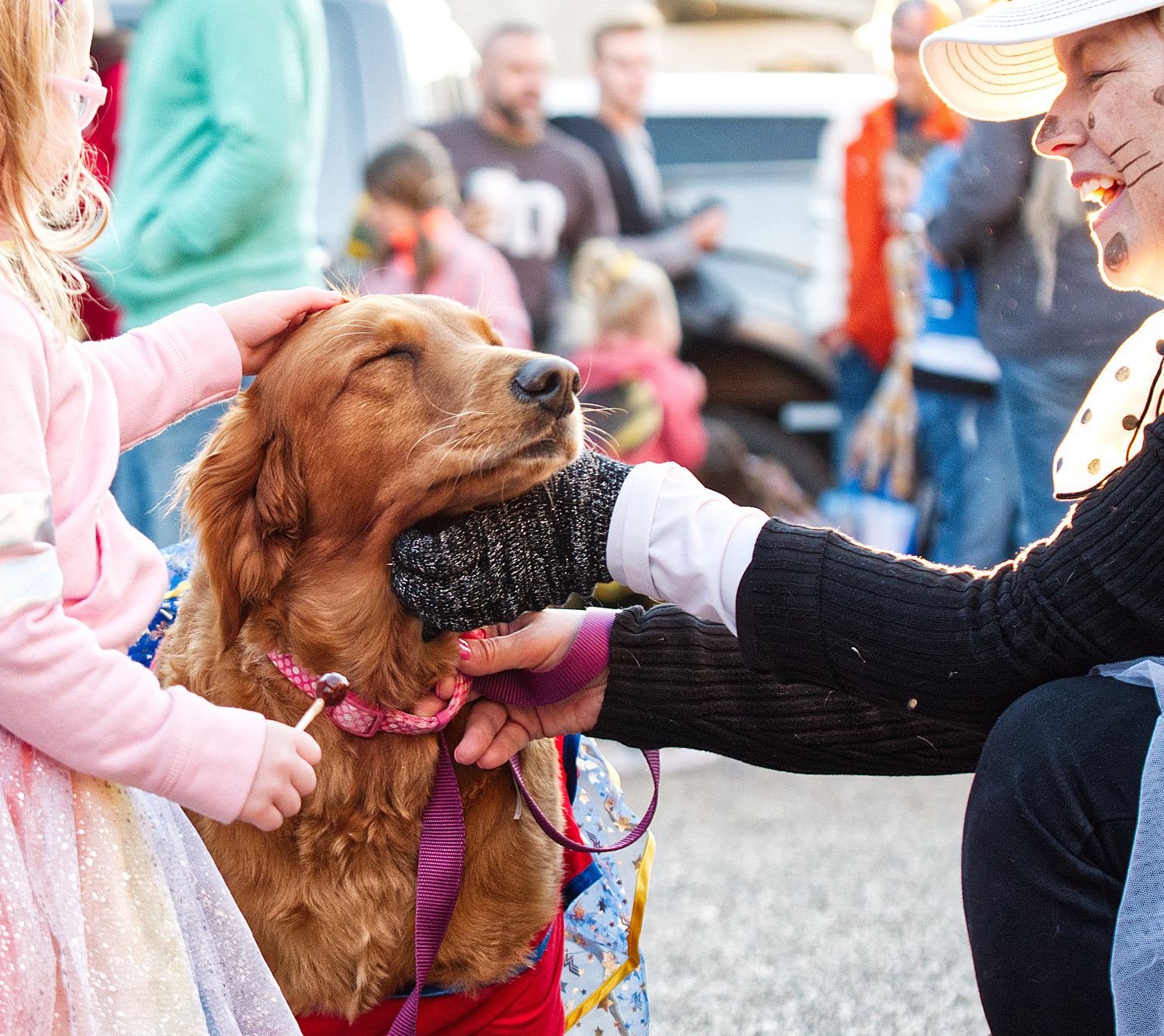 Jamie Johnson (r) and dog Maxi at trunk or treat in downtown Mineola.
