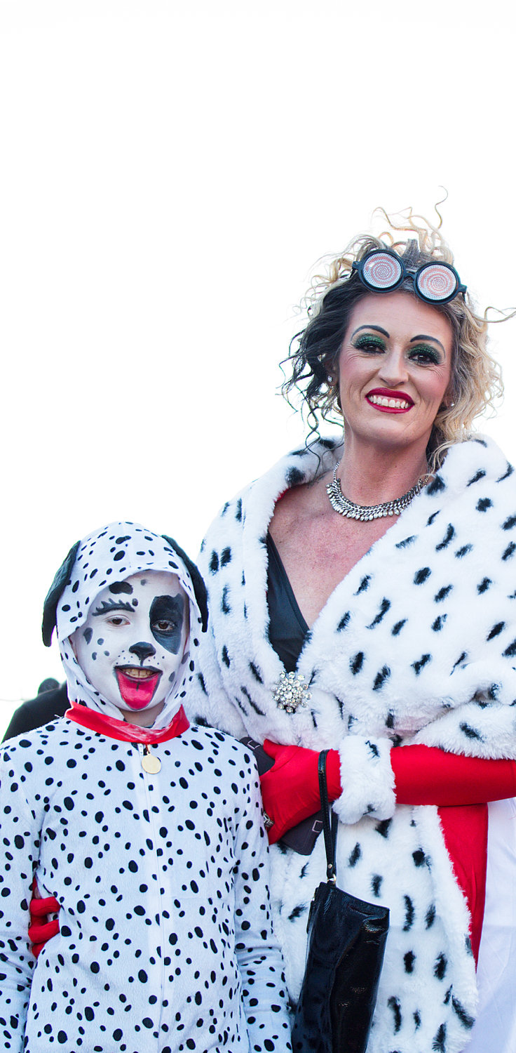 Cruella DeVille poses with one of her future furs in Downtown Mineola on Halloween.
