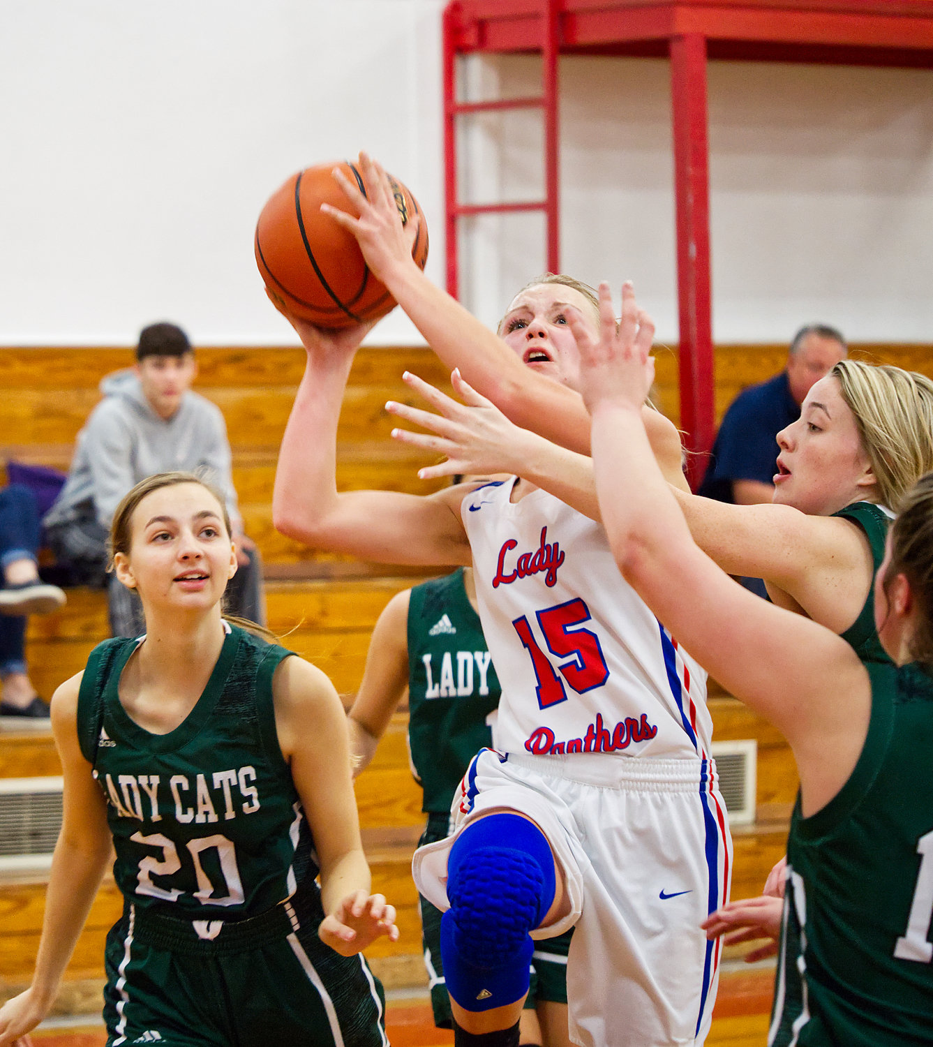Bella Crawford (15) drives to the basket to score two of her fifteen points on the evening.
