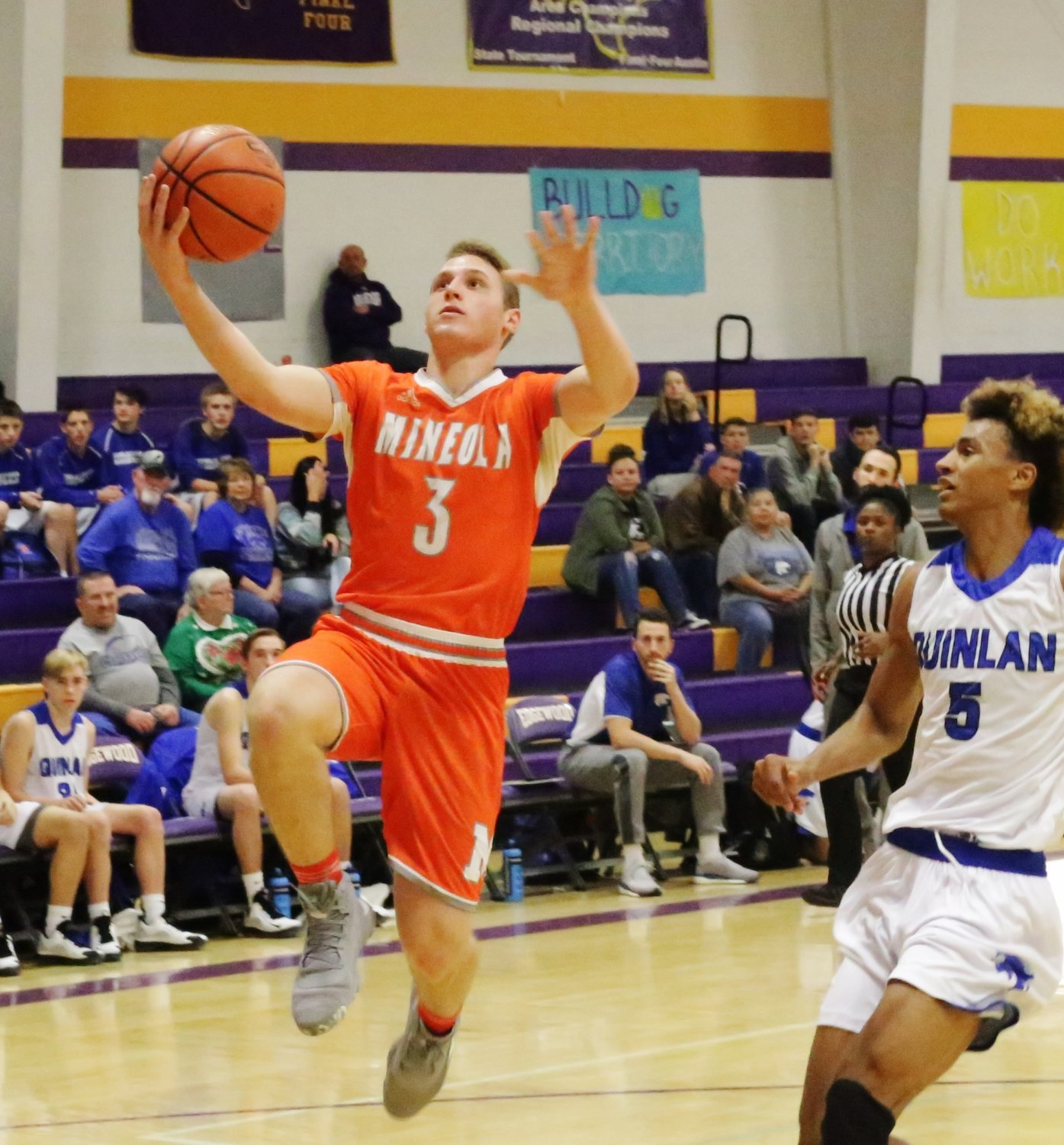 Point guard Jonah Fischer drives to the basket in action against Quinlan-Ford.