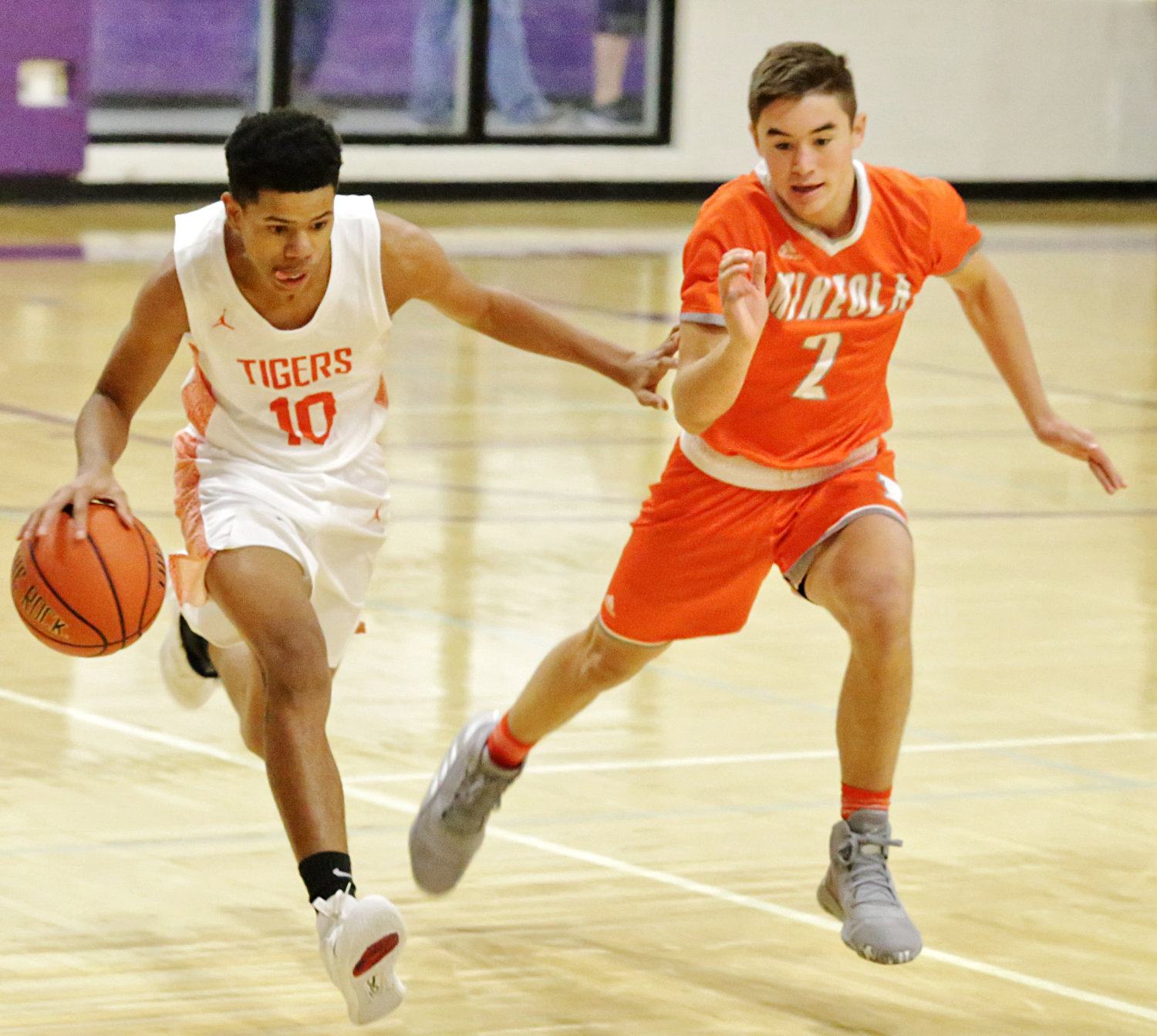 T.J. Moreland, right, of Mineola presses the ball in tourney play against Commerce.