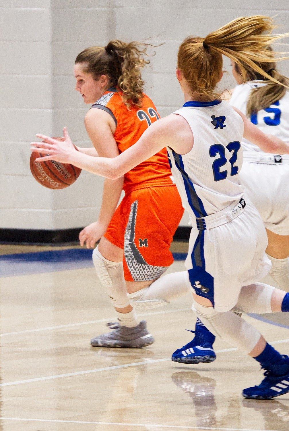 Cyndi Butler (22) uses her dribble to break the Rains backcourt press.