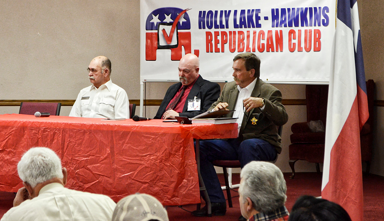 Wood County sheriff's candidates, from left, James Schaffner, Kelly Cole and Tom Castloo field questions during a forum at Holly Lake Ranch Monday. Callie Lawrence was unable to attend.