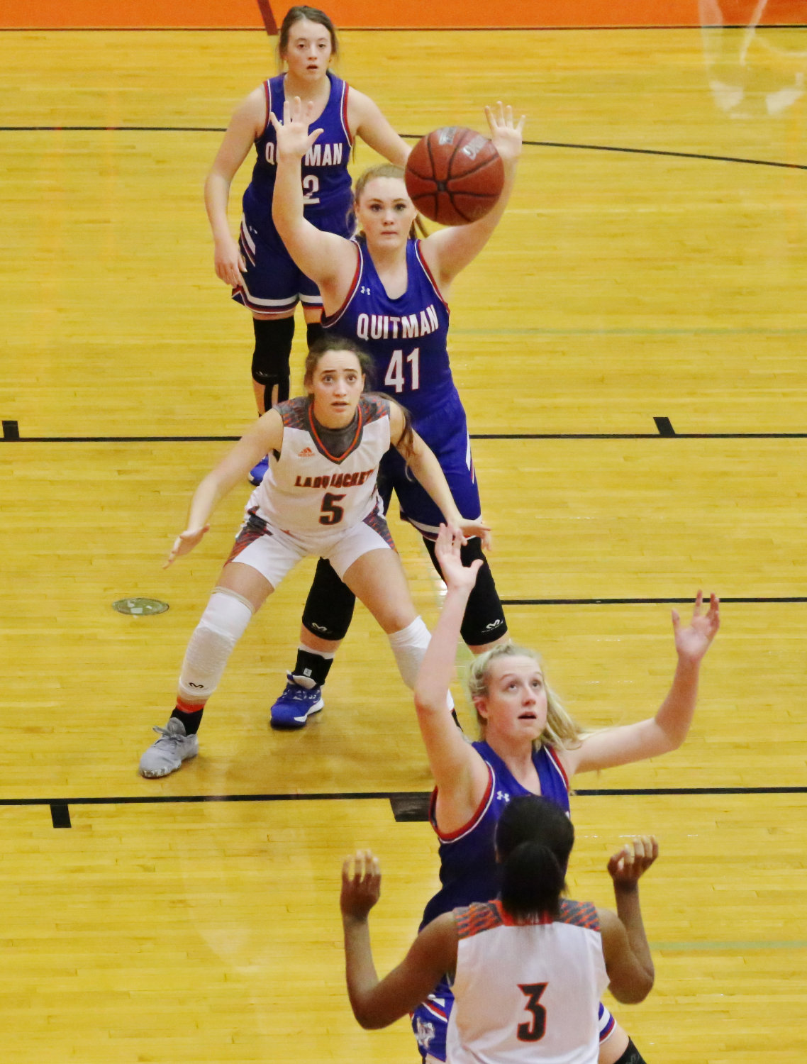 Lady Jacket Kelsey Brewington (5) guarded by Quitman's Reiny Luman (41) prepares to take a pass from Sabria Dean (3) in action last Friday.