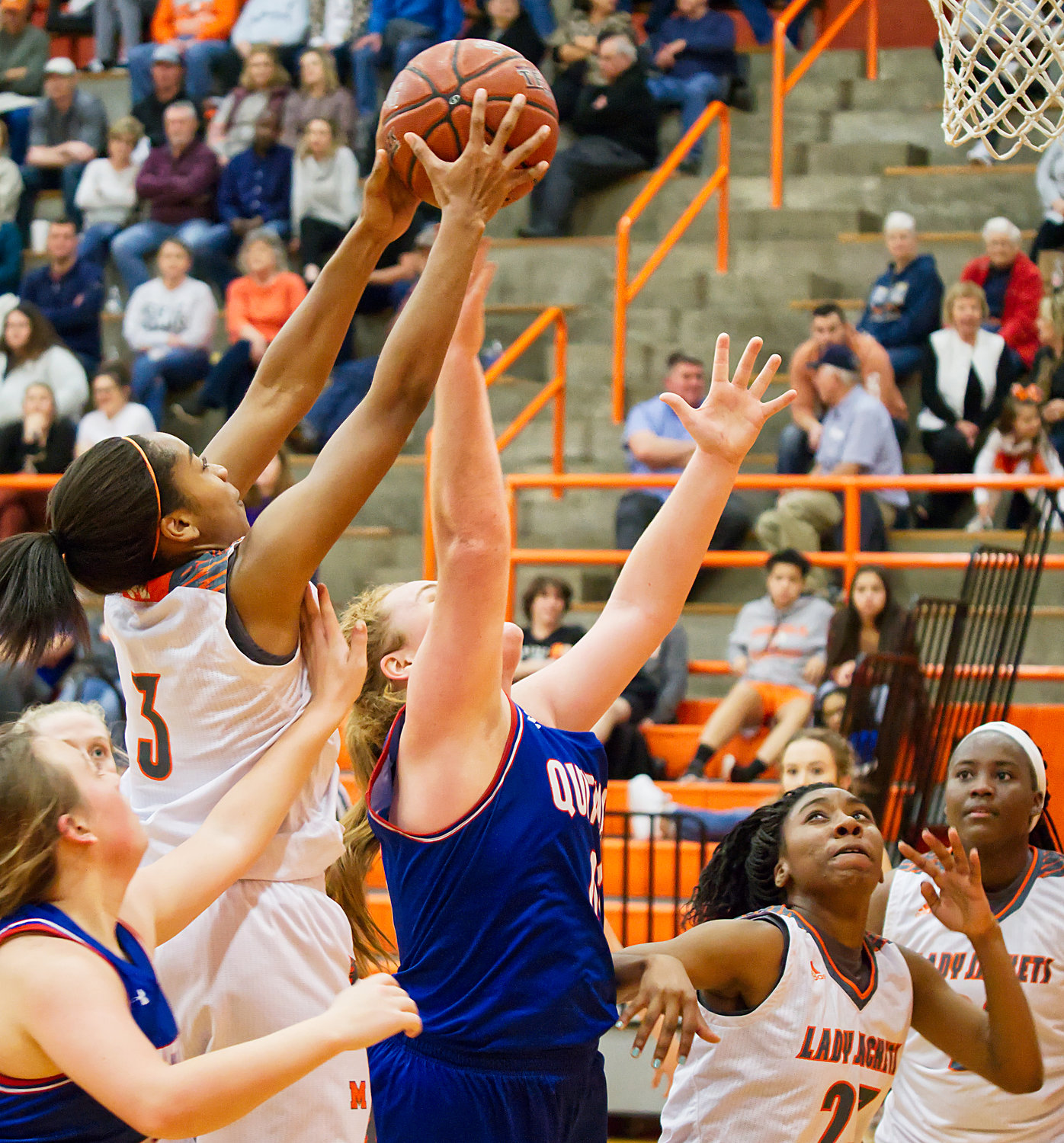 Mineola's Sabria Dean (3) skies for the board over Quitman post Reiny Luman.