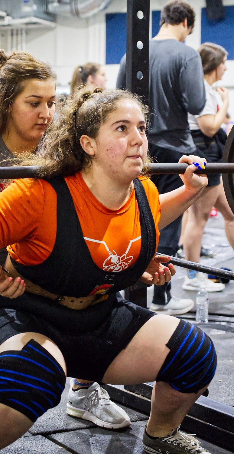 Izzy Tresca of Mineola competes in the squat, clearing 365 pounds to lead her classification. Tresca would go on to win her class overall.