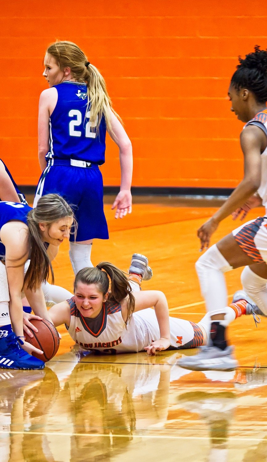 Cyndi Butler gets on the ground to track down a loose ball.