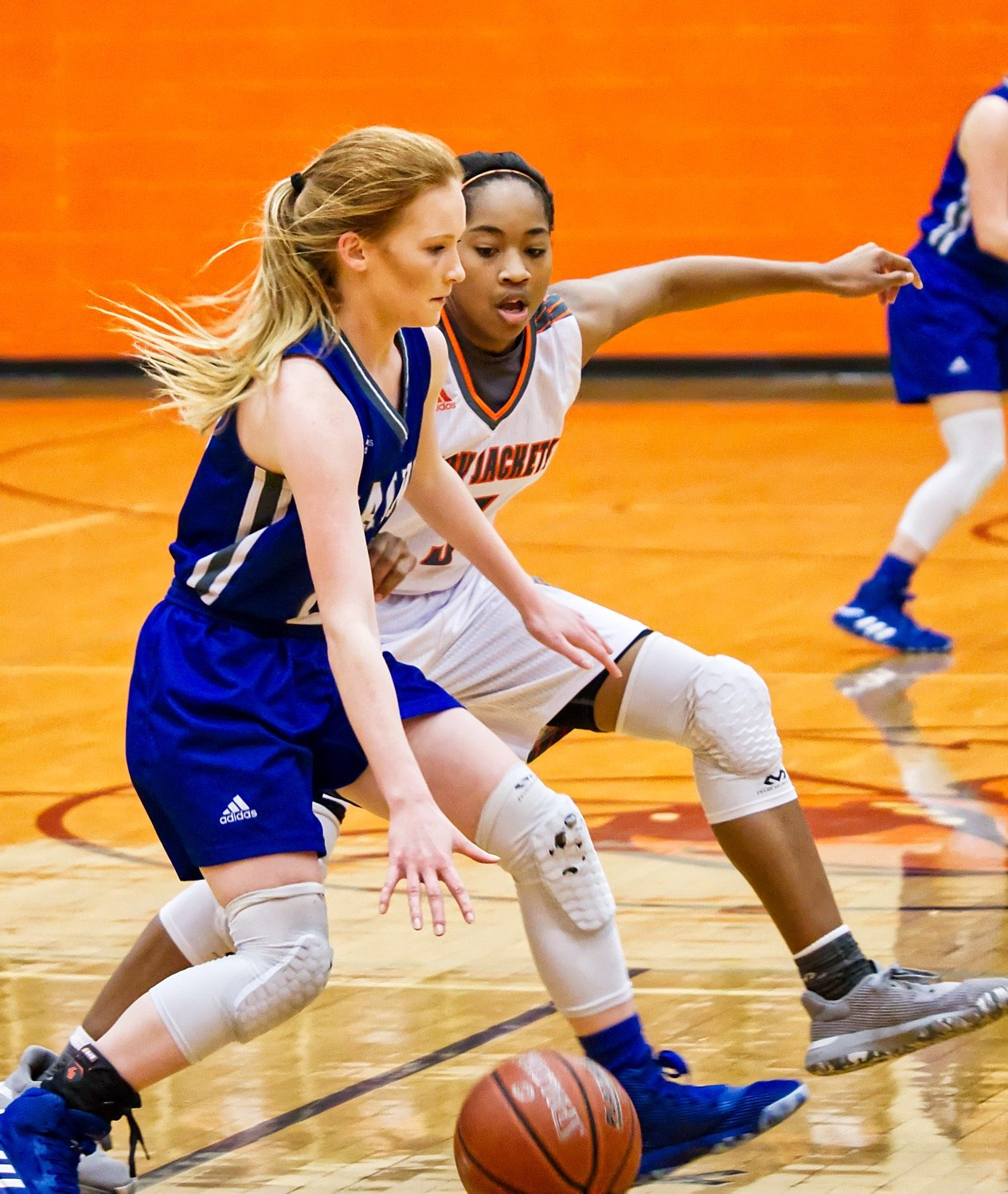 Sabria Dean stays step for step guarding the Rains guard in the backcourt.