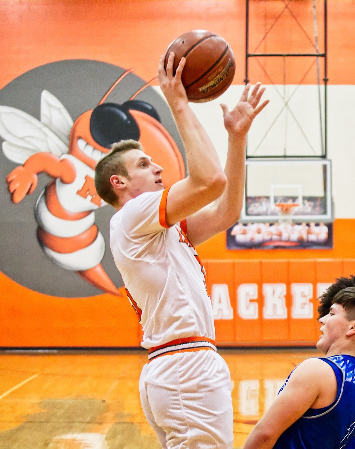 Jonah Fischer, name District 12-3A MVP, fires a jumper over the Rains defense.