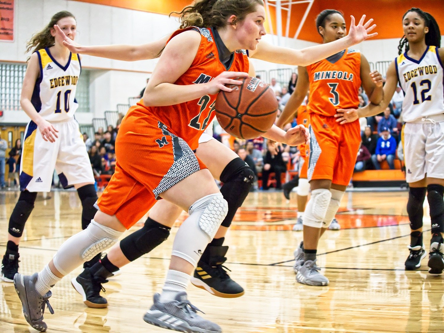 Driving past an Edgewood defender in Grand Saline, Cyndi Butler contributed to a Lady Jacket win, despite being ill, giving Mineola a district championship and propelling them into the playoffs.