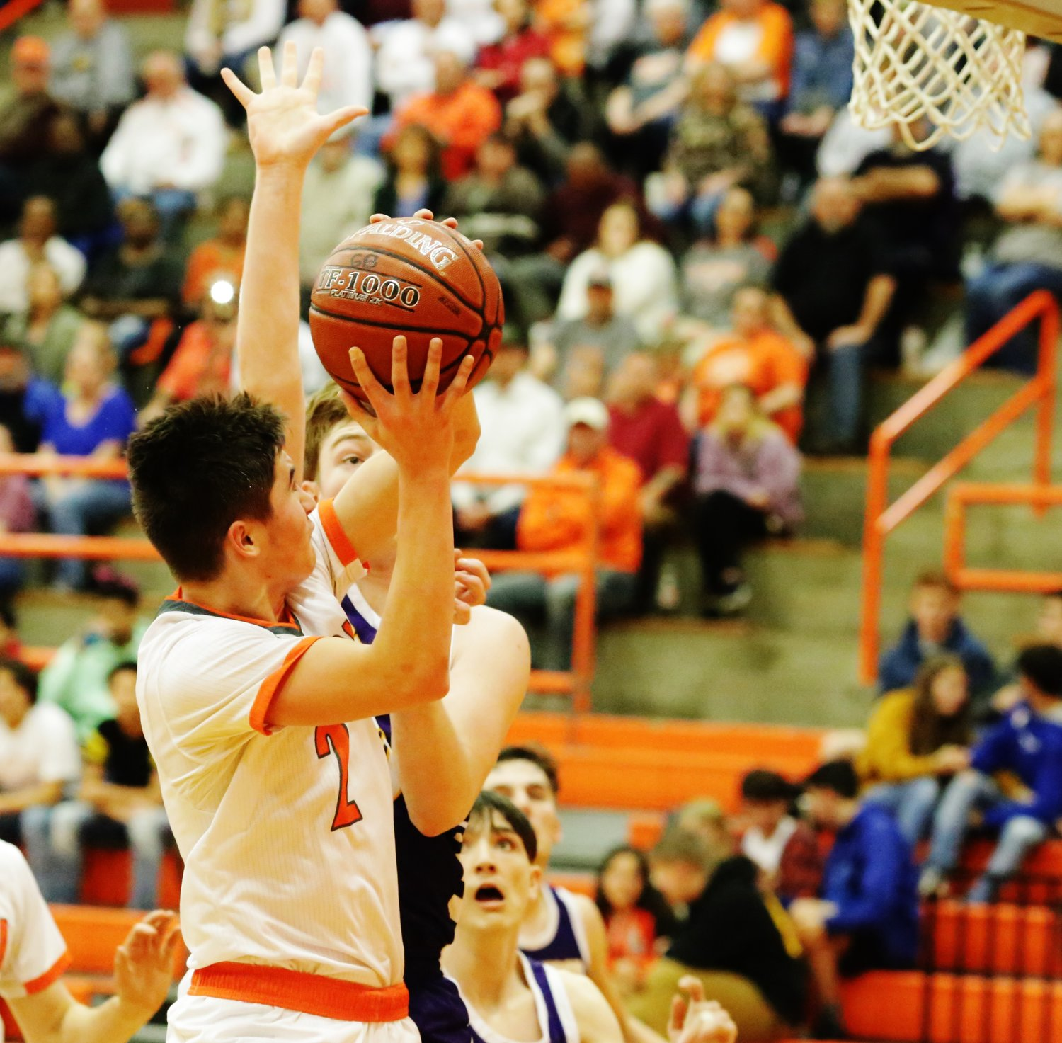 Yellowjacket T.J. Moreland puts a shot up over an Edgewood defender in Mineola's win last Tuesday.
