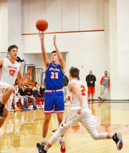 Jace Reid takes a long shot against Grand Saline earlier this year.