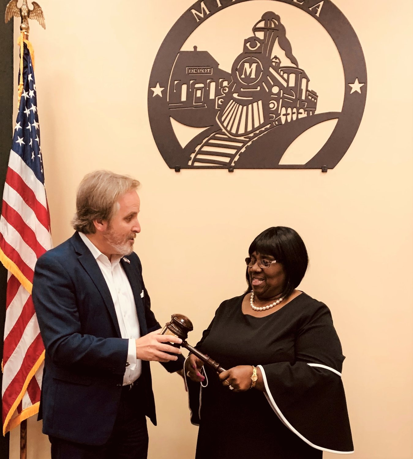 State Senator Bryan Hughes presents a state of Texas gavel to Novada Bigham, who has served on the Mineola City Council for 22 years. (Courtesy photo)