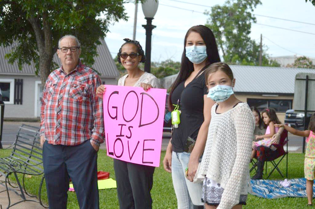 There was a peaceful protest at the Wood County Courthouse Monday morning attended by several local citizens. Pictured are (left to right) Vernon Olmsted (Bohannon's grandfather), Kimberly Bohannon (protest organizer), Ashley Lance and Milo Reed.