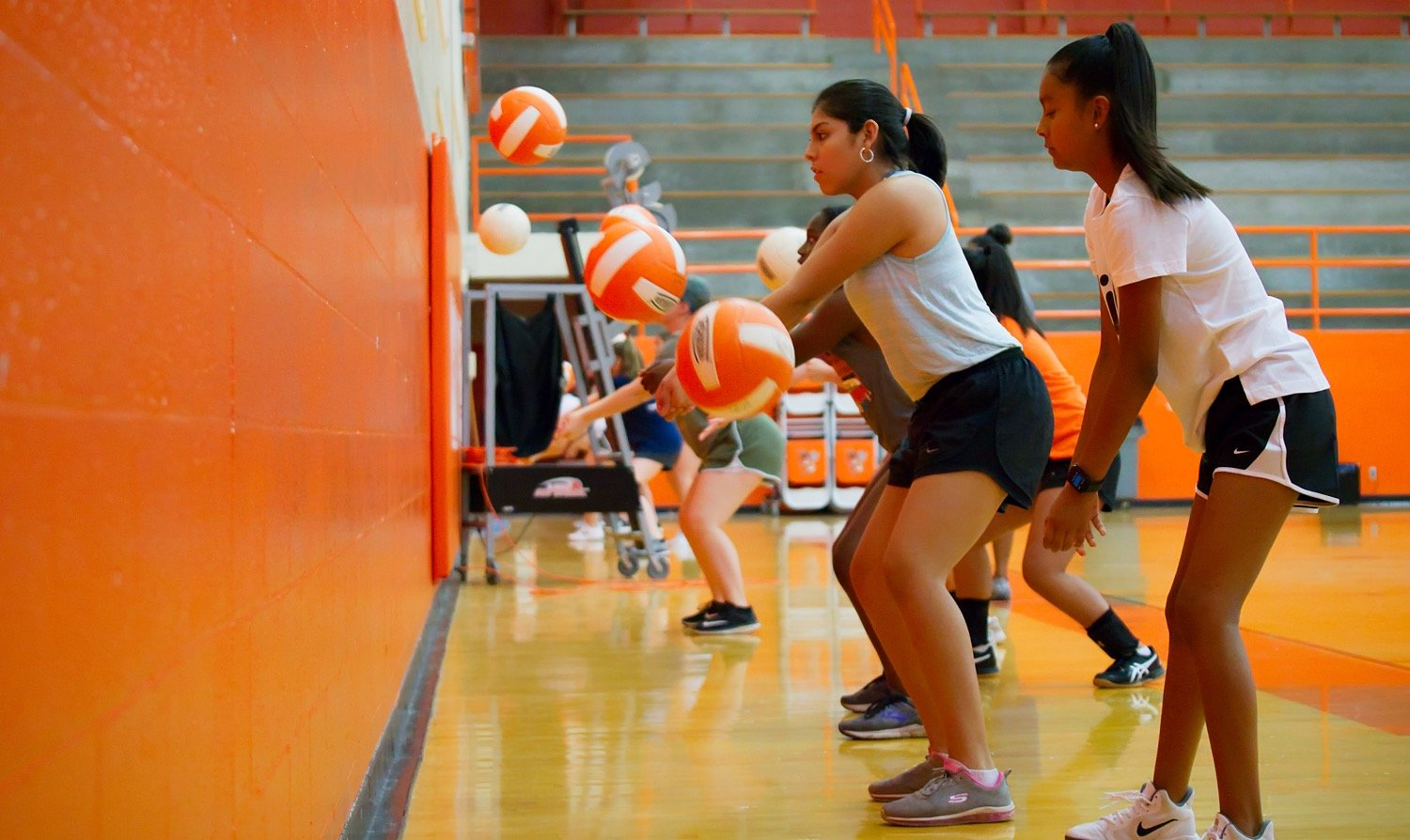Volleyball drills started shortly after 9 a.m. Monday morning.