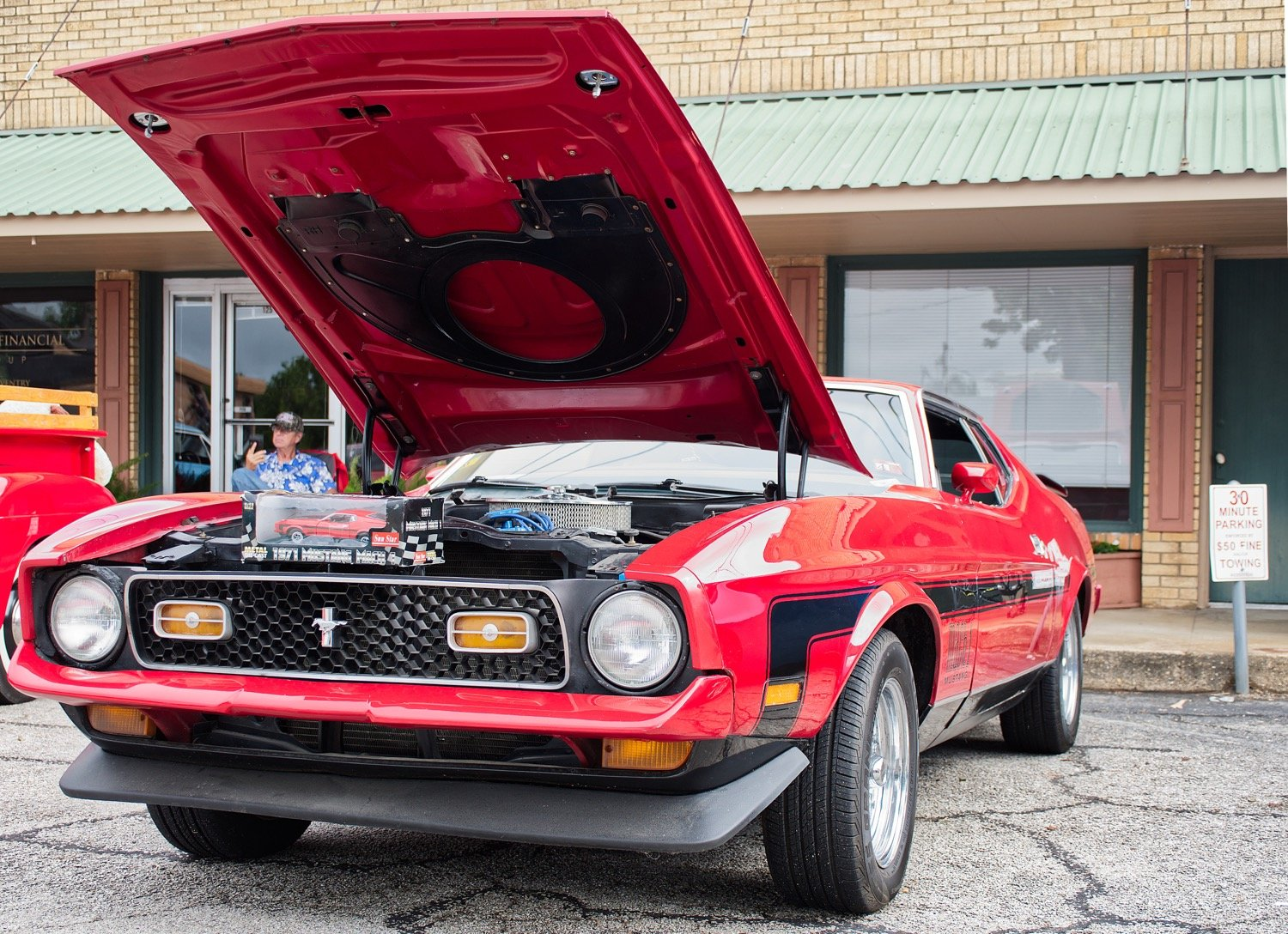 Among the various Ford models was this 1971 Mustang Mach 1, along with its miniature scaled down replica.