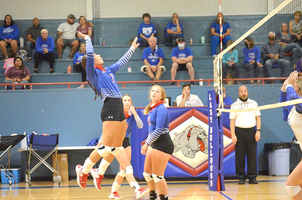 Quitman's Brooklyn Marcee goes high for a kill against Wills Point last Tuesday at Ballard Gym. (Monitor photo by Larry Tucker)