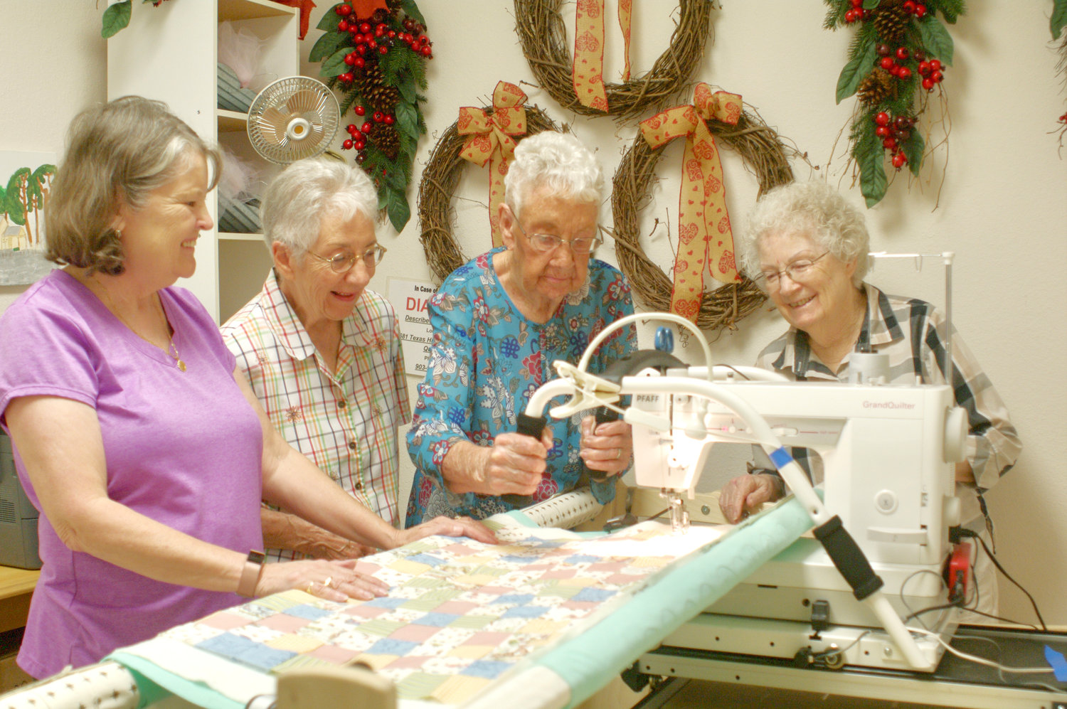 From left, Priscilla Massey, Winnsboro; Donna Benge, Quitman; Teddy Shampine, Quitman; and JoAnna Nelson, Quitman check the new quilting machine's operation. (Courtesy photo Dean Benge)
