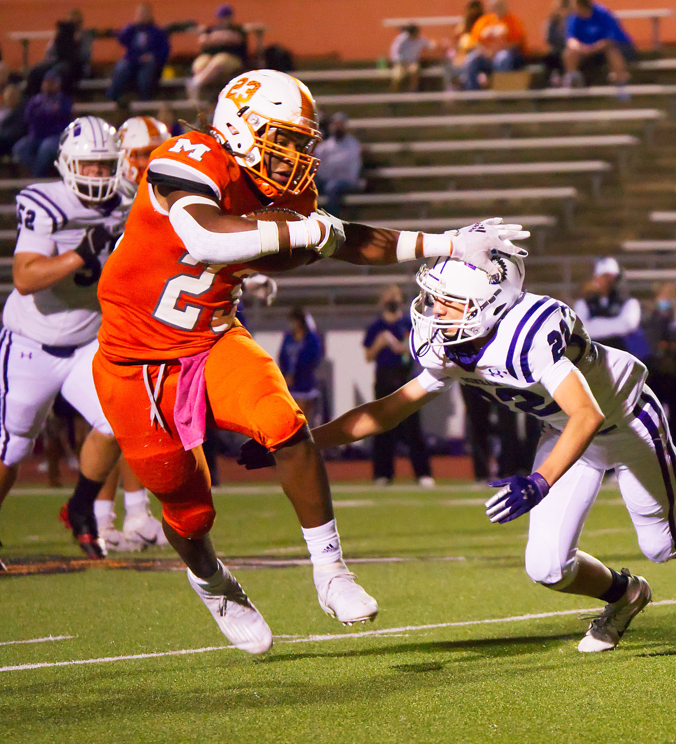 Trevion Sneed of Mineola avoids a would-be tackler in the game against Bonham. (Monitor photo by Sam Major)