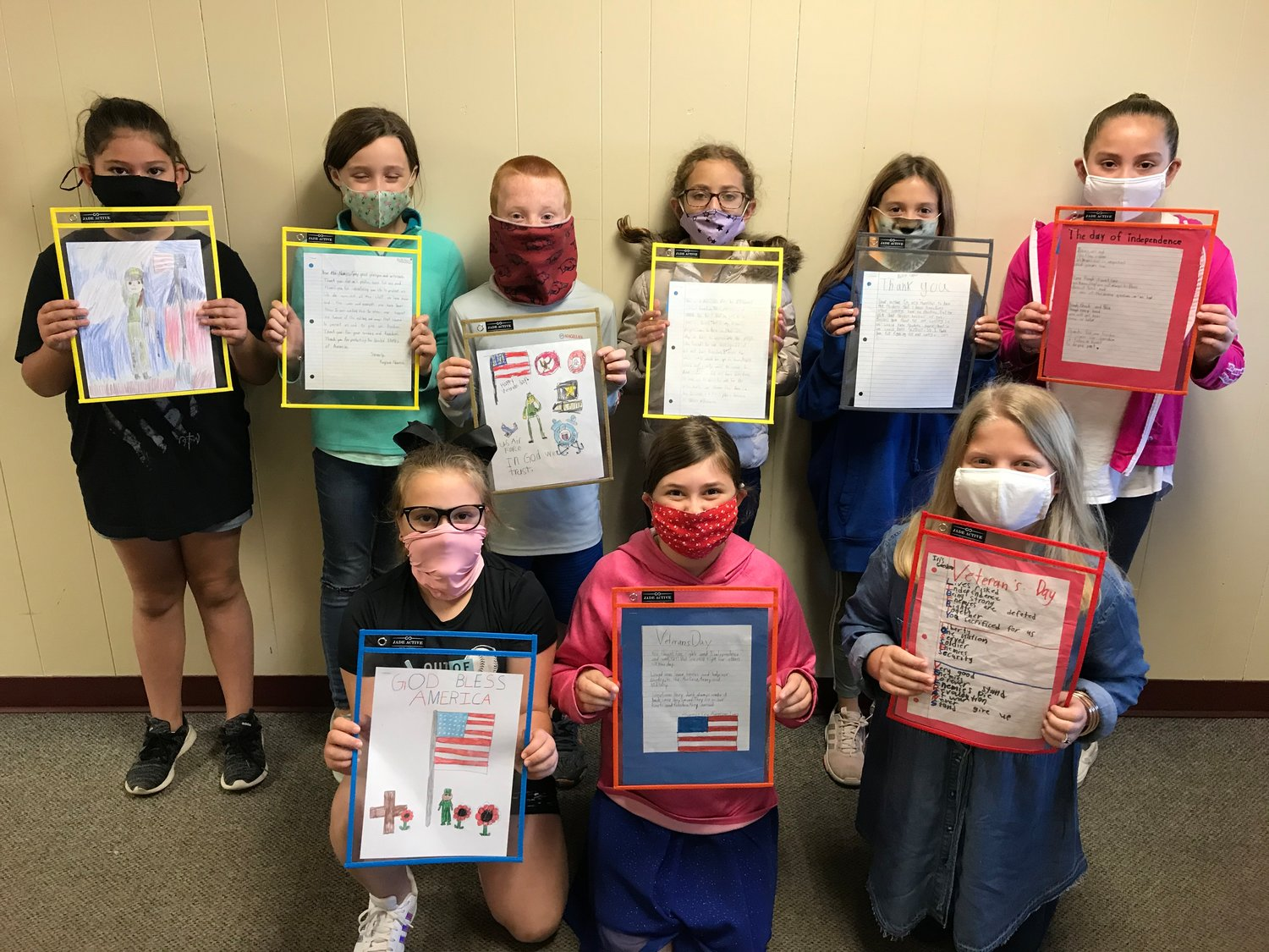 Winners of the Mineola Pilot Club patriotic challenge were, back from left, Lilah Dougherty, Kaylee Nance, J.D. McGough, Julieane Hoff, Bella Exner and Paislee Hall; and, front, Kinsler Bowker, Callee White and Iris Goodson. (Courtesy photo)