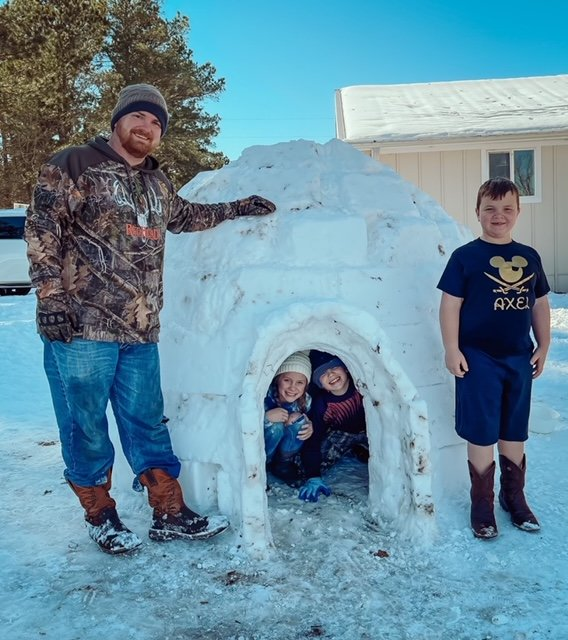 Brandon Roberts and sons Axel (outside) and Camden spent about 10 hours constructing an igloo using 98 blocks.