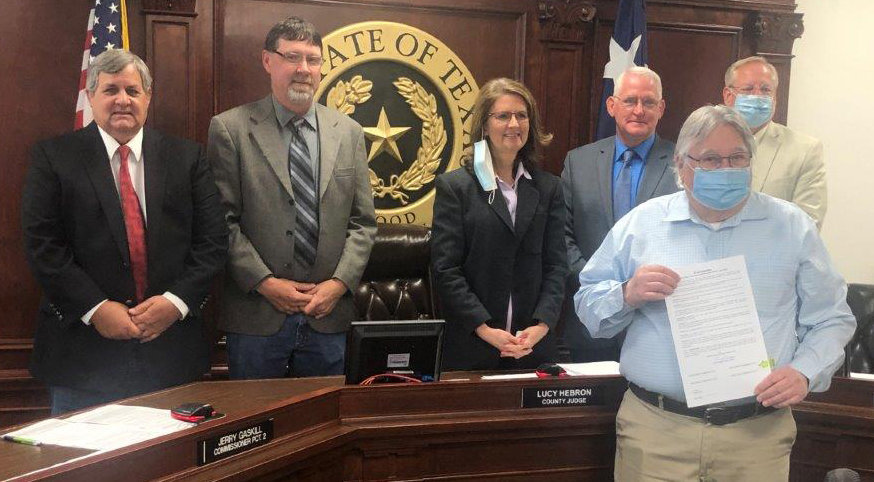 Wood County Child Welfare Board President Sam Scroggins is pictured with a proclamation making April Child Abuse Awareness and Prevention Month. Behind Scroggins are Virgil Holland, Jerry Gaskill. Judge Lucy Hebron, Mike Simmons and Russell Acker. (Monitor photo by Larry Tucker)