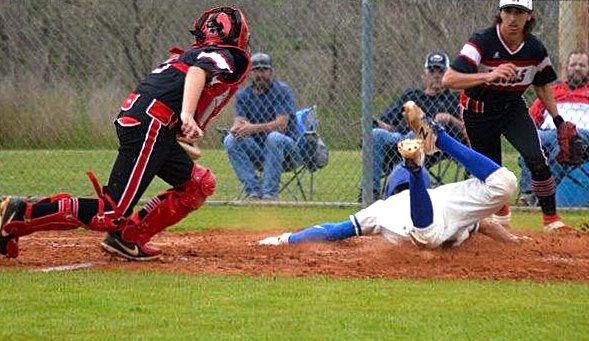 Quitman's Ty Holland hustles to the plate with a headfirst slide to score in Friday's win over Mount Pleasant Chapel Hill.