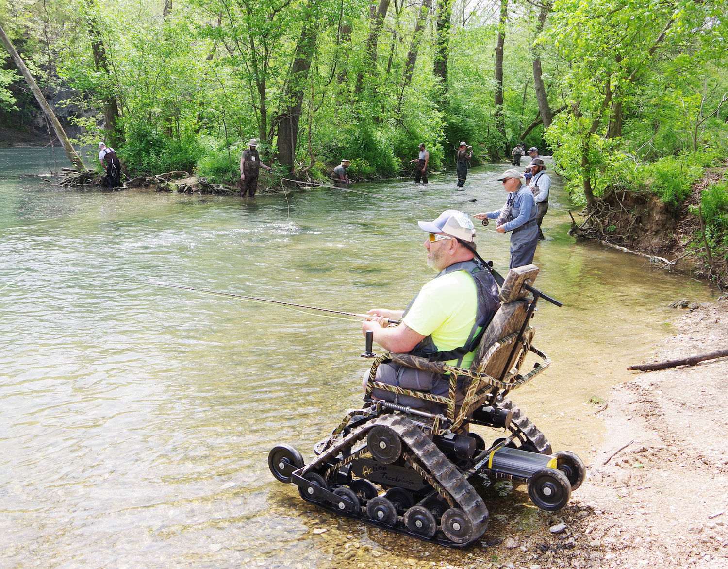 Wally Parker makes use of a track chair loaned to him by the Missouri Department of Conservation as he pursues his share of the 2,500 trout released for Veterans Free Fishing Day.