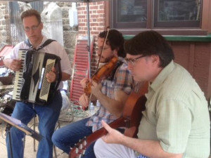 David Graves (left) is seen performing with the other members of the Quarter 'til Four Trio:Steve Kadlecek on violin and Daniel Boehmcke on guitar. (Photo by Daphne Dennis)