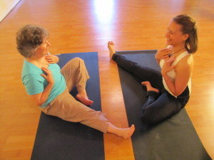 Susan Windle (left), a poet from Mt. Airy, is obviously enjoying her session with Daralyse Lyons, founder of Mt. Airy-based Emotional Yoga.