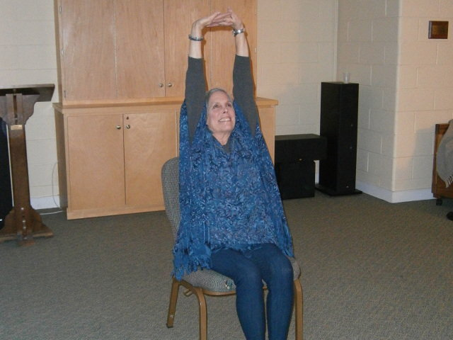 """Barbara Levitt, a yoga teacher for 42 years and author of """"Golden Yoga,"""" teaches. """"seated"""" yoga classes twice a week in Chestnut Hill for elderly people who aren't able to do exercises on the floor. (Photo by Meredith Sonderskov)"""