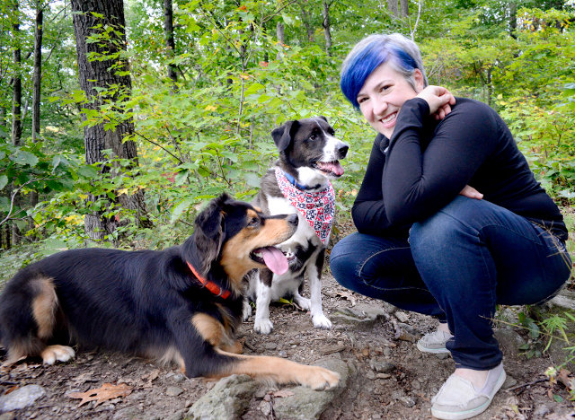 Adina, who started Queenie's Pets nine years ago, passed up a career in Washington politics to surround herself with canine energy. She is seen here with her own rescue dogs MeloDrama, 4 (right), and Governor Monkey, age 7.5.