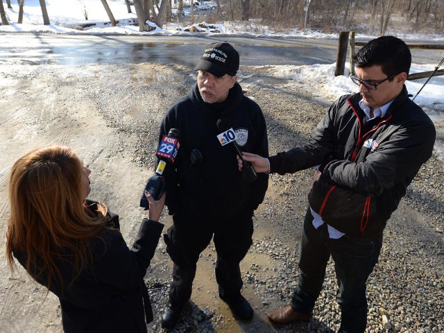 Mt. Airy resident Mark G. Hopkins, chief of Greater Philadelphia Search and Rescue, answers television reporters questions regarding a recent missing person's case. (Photo courtesy of Greater Philadelphia Search and Rescue)