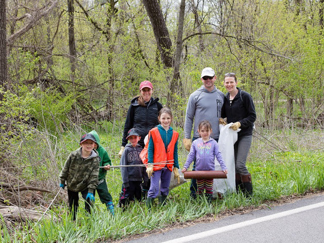 Emily Bergson-Shilcock, Katelyn Ginsberg and Christopher Conklin, of Fort Washington, and their children are seen during a recent Wissahickon Creek cleanup by volunteers. (Photo by Jamie Stewart)