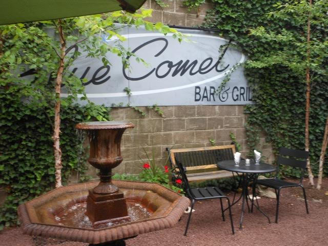 The courtyard at Blue Comet is a pleasant place to dine in spring-like weather. (Photo by Judy Rubin)