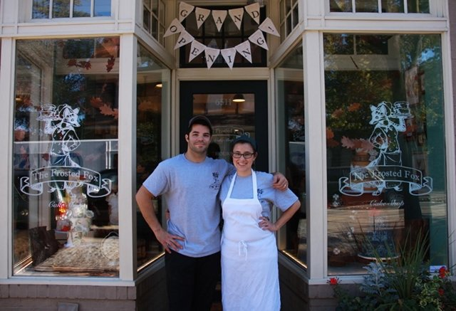 Sean Williams and Jennifer Low stand proudly in the front of  the Frosted Fox Cake Shop, which they just opened at 6511 Germantown Ave. (Photo by Susannah McLean)