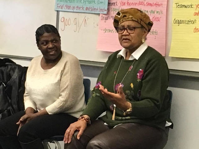 """Karen Asper Jordan (left) and Bernyce Mills-DeVaughn, who were both members of the """"Young Militants,"""" an advovacy group that marched for seven months and 17 days to protest the segregation of Girard College, a free boarding school for poor white orphan boys, talk to eighth graders at Wissahickon Charter School about their experiences as """"Freedom Fighters."""" (Photo by Ken Weinstein)"""